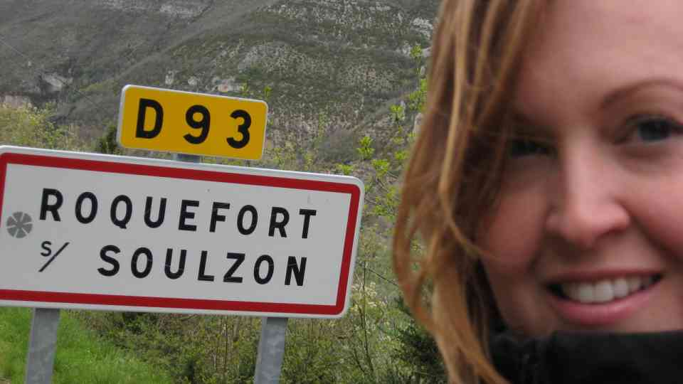 Seana with Roquefort street sign