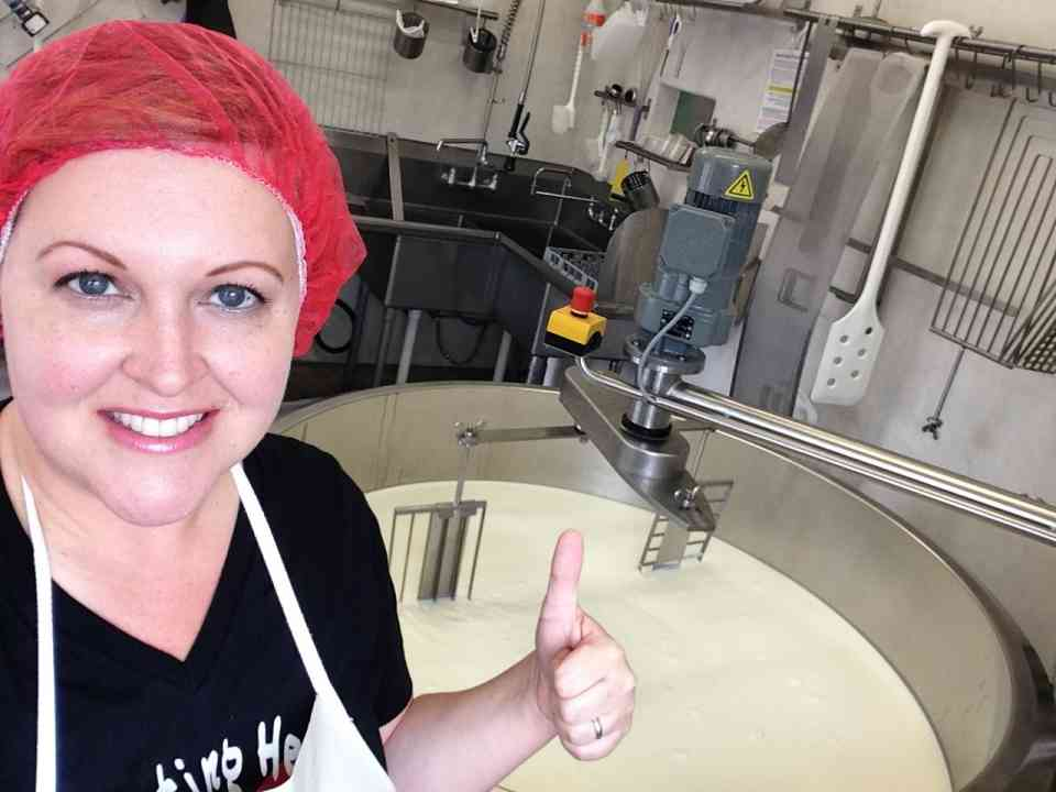 Seana at vat making cheese